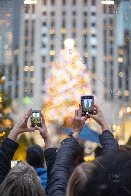 December 3, 2018: Tourists photographing the Christmas tree at Rockefeller center in New York City