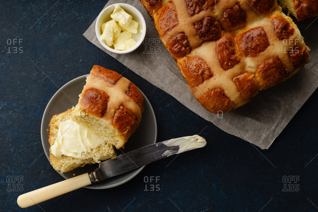 Holiday easter hot cross buns with butter