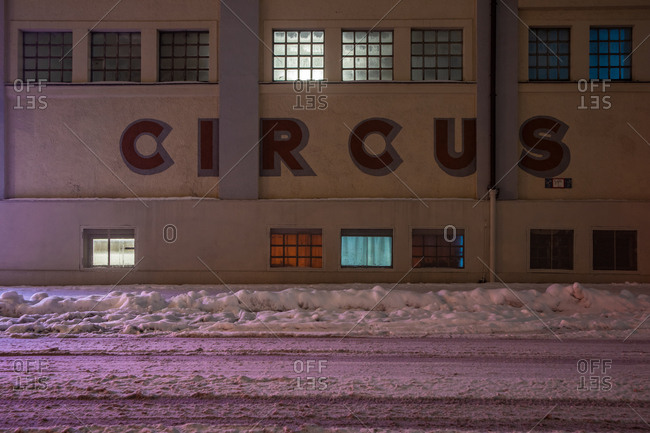 Night shot of an industrial building with the word Circus, on a snowy street