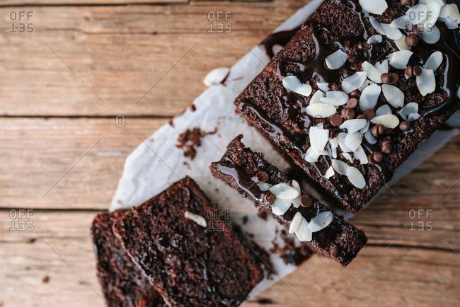 Chocolate bread cake sliced on wood background