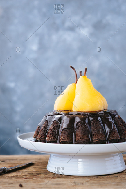 Poached pears on top of the chocolate cake baked in baking mold