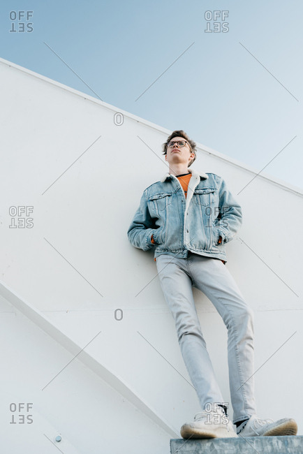 Portrait of young man in early twenties looking up at sky