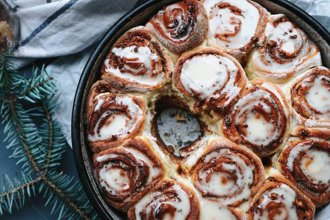 Close up of baked cinnamon rolls with sugar syrup on top