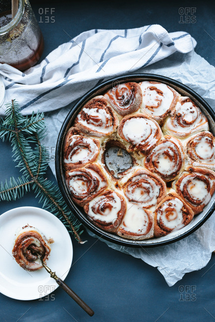 Fresh baked cinnamon rolls with sugar syrup on top