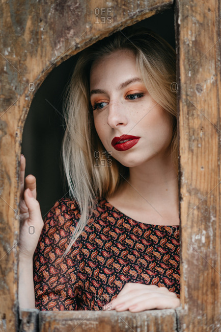 Portrait of blonde young woman in boho dress