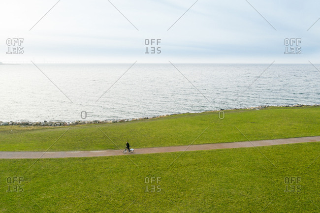 Malmo, Sweden - February 13, 2019: Person riding bike by the sea in Sweden