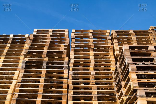 Large stacks of wooden pallets