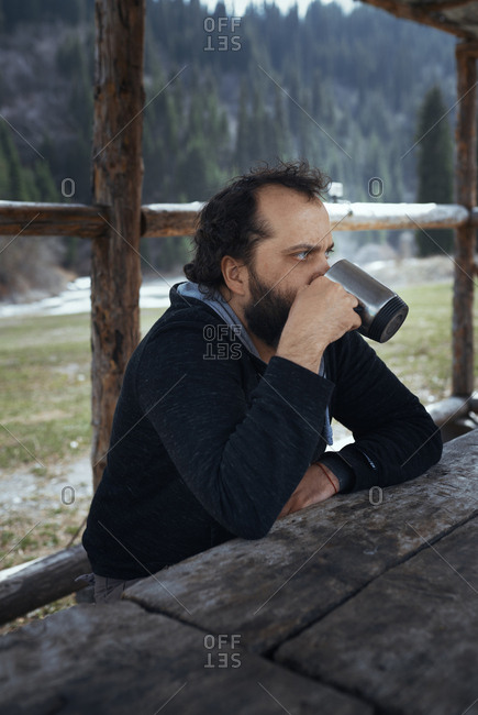 Bearded Man Having Drink While Camping