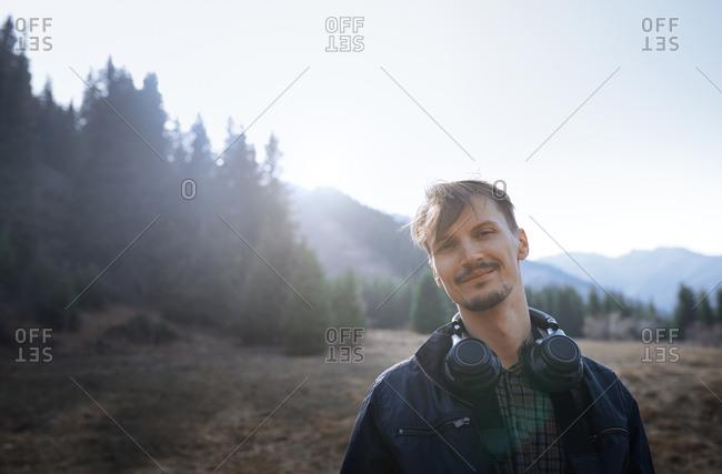 Man outdoors wearing headphones