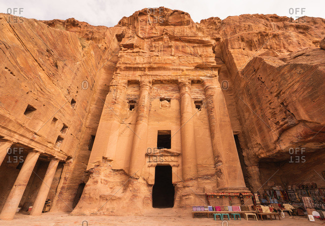 Exterior of building carved in massive cliff in ancient city of Petra, Jordan