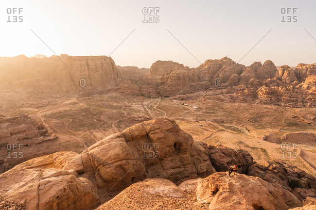 Panoramic view of picturesque desert with cliff formations in sunset light, Jordan