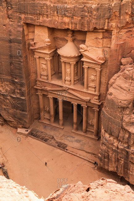 From above view of carved Petra temple in solid sandstone cliff, Jordan