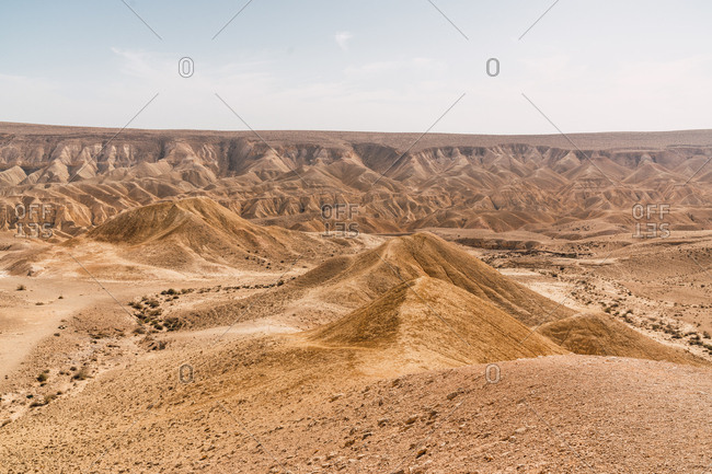 Panorama of majestic hot Negev desert with spacious dry valley in sunshine, Israel