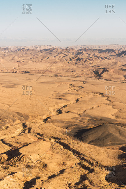 Landscape of sand dunes on spacious terrain of Negev desert in bright sunlight, Israel