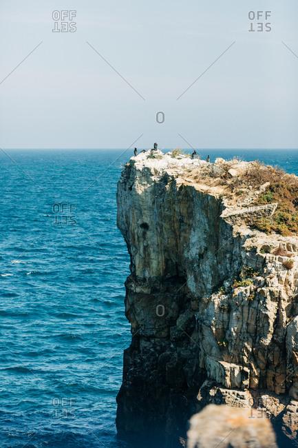 Rough cliff in blue sea
