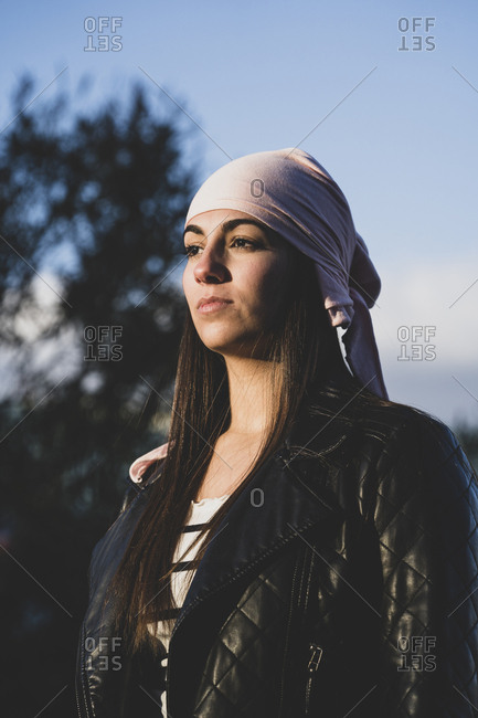 Young beautiful woman with cancer bandana