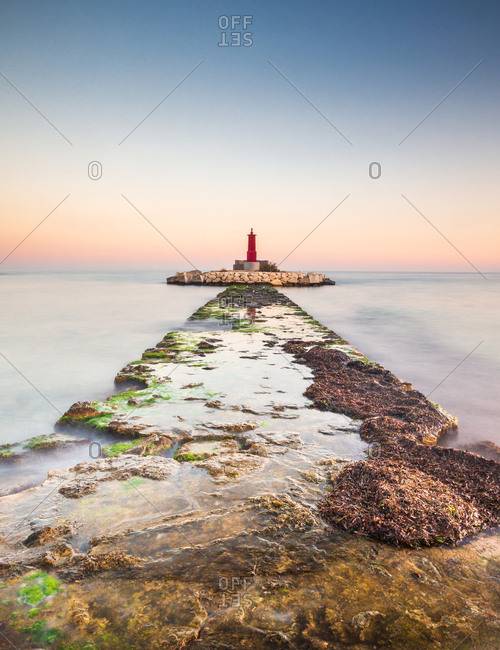 Rough path to islet with lighthouse