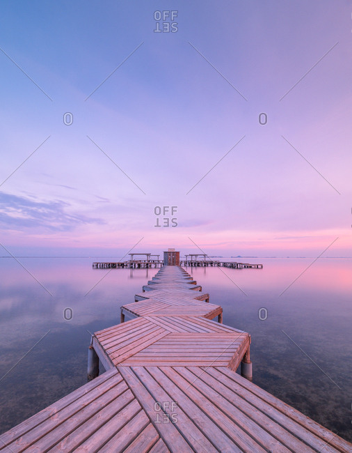 Wooden pier on cloudy evening