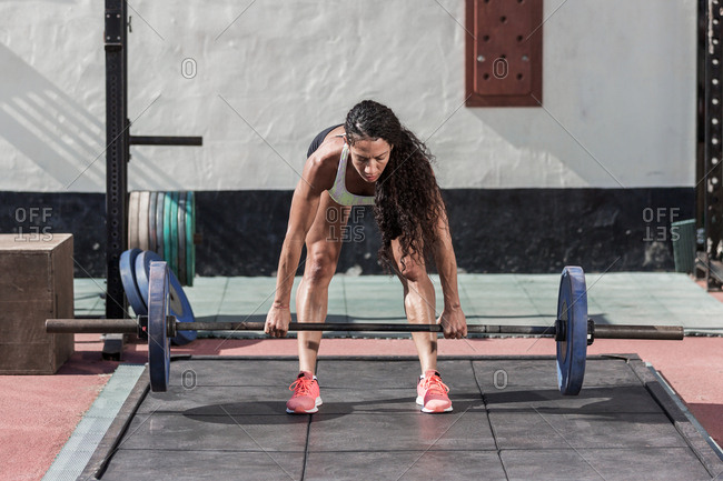 Woman dead lifting barbell