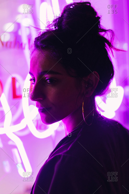 Attractive stylish lady near neon lights