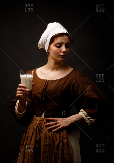 Medieval maid with glass of milk