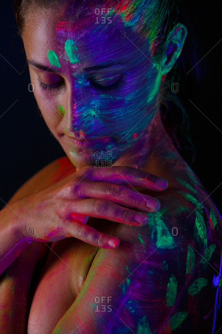 Topless model in neon lights