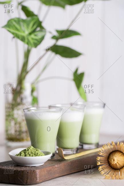 Preparing matcha latte beverage