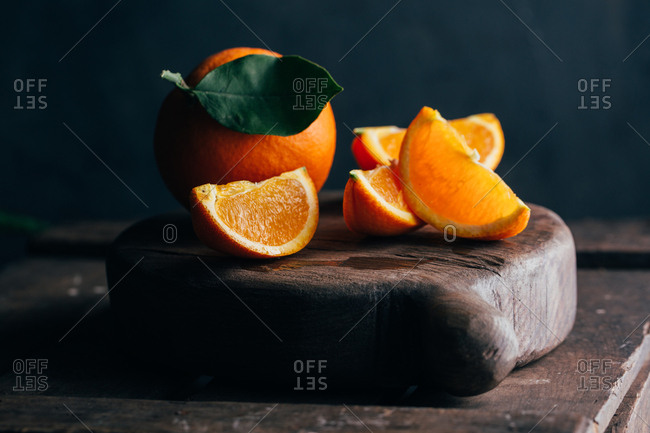Fresh cut oranges on dark moody background