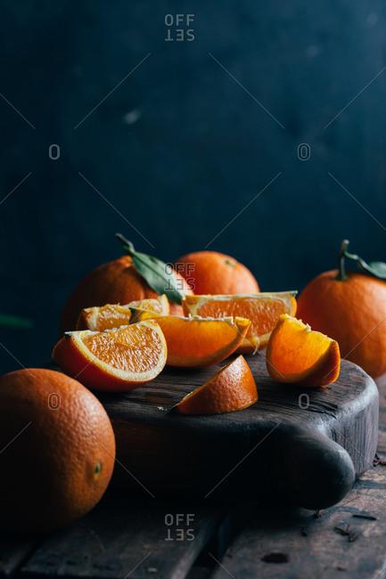 Fresh cut oranges on dark moody background