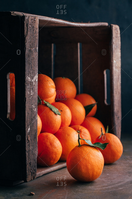 Fresh oranges in an old wooden box