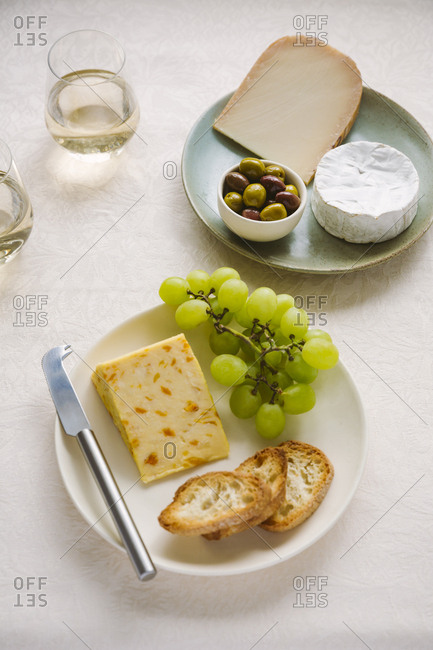 cheeses with grapes and olives
