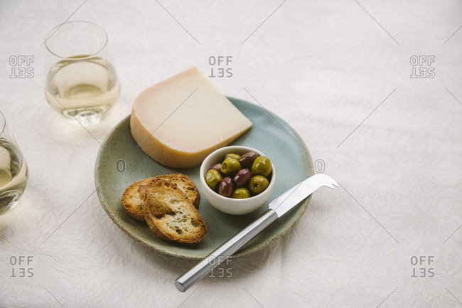 plate of gouda cheese and olives horizontal shot