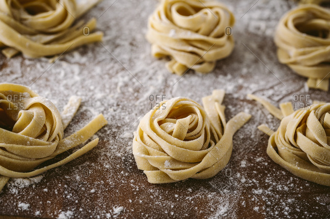 horizontal shot of fresh fettuccine bundles