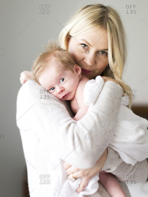 Woman holding her baby son
