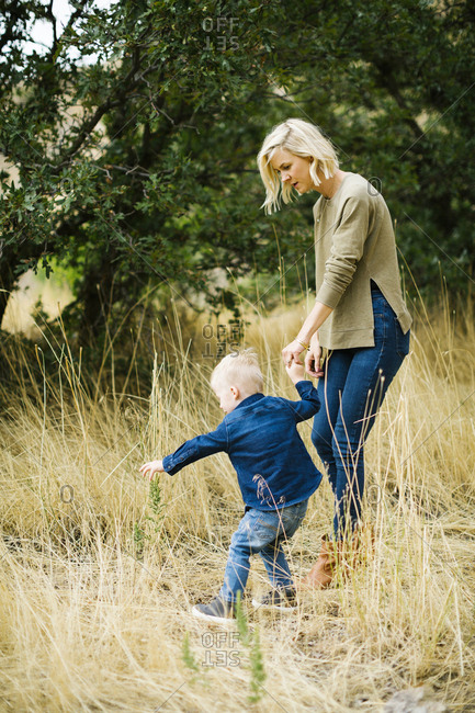 Mother and son walking in tall grass