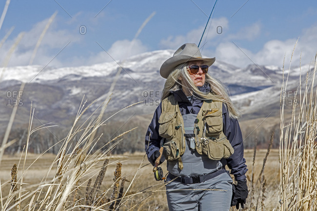 Woman in waders and cowboy hat