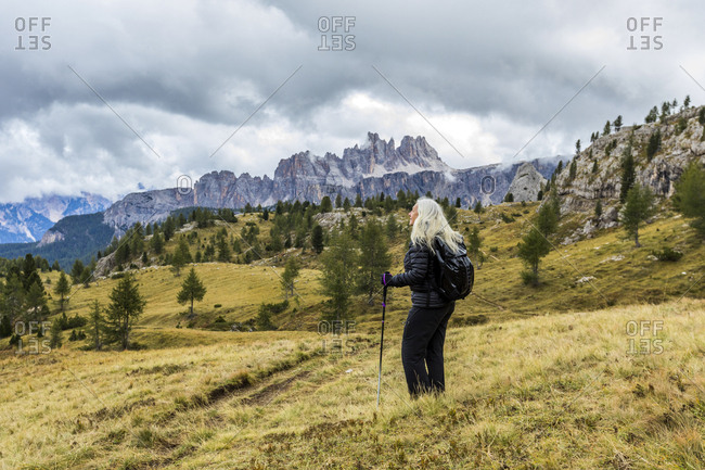 Woman hiking at Giau Pass in the Dolomites