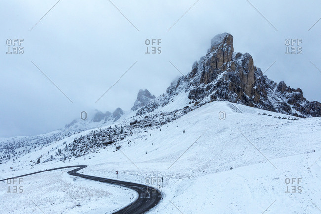 Road at Giau Pass during winter in the Dolomites