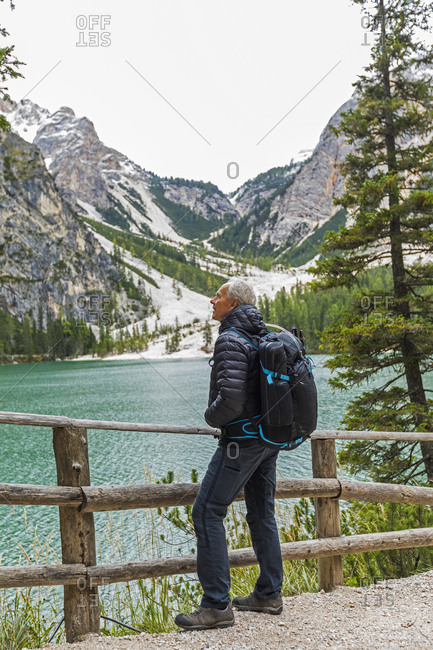 Man with backpack at Pragser Wildsee in South Tyrol, Italy