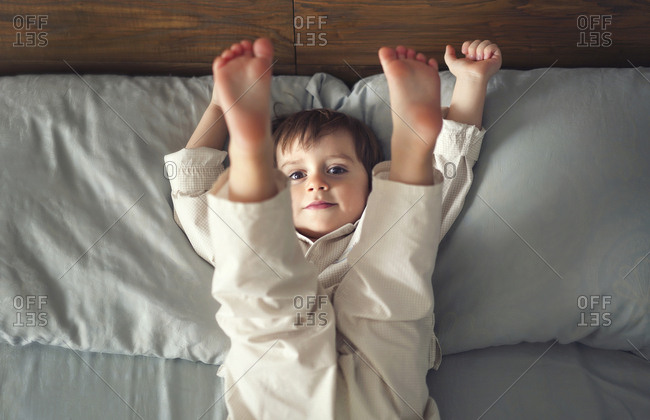 Boy playing on bed