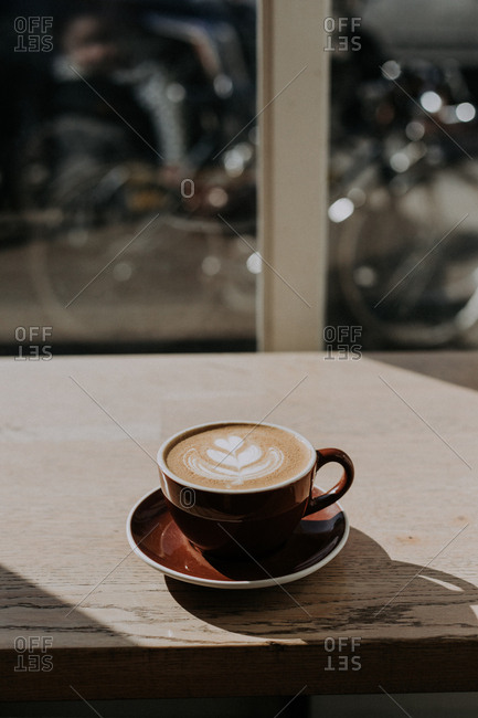 Cappuccino sitting by window
