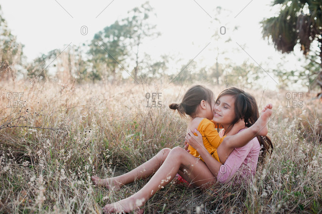 Two sisters cuddling - Offset Collection