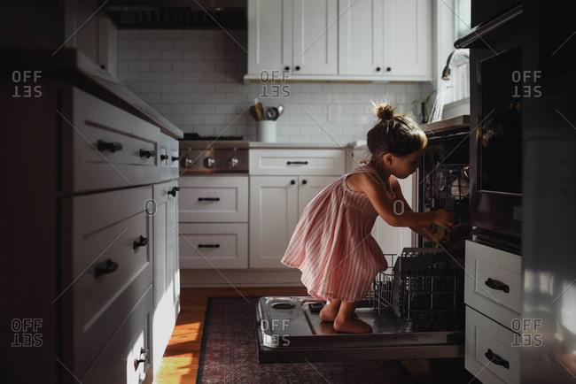 Toddler loading dishwasher - Offset Collection