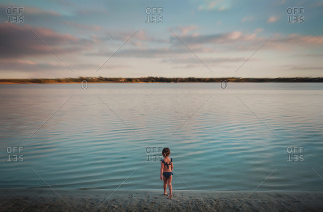 Toddler walking into the lake water