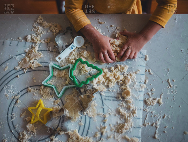 Overhead view of toddler hands making cookies