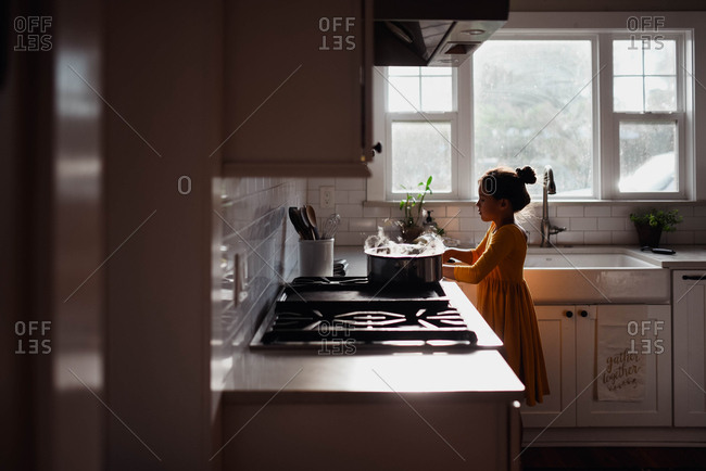 Tween cooking in the kitchen