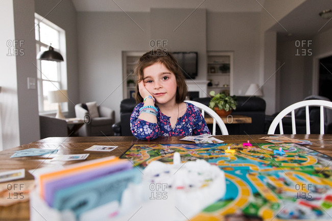 Little girl playing board game