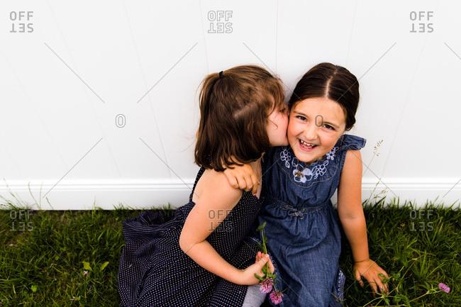 Girl giving sister a kiss on her cheek