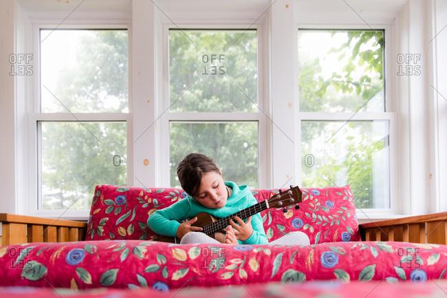 Girl playing small guitar