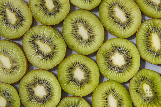 Close up of kiwi fruit slices on gray background